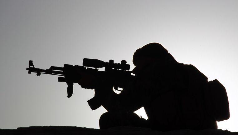 Het silhouet van een Koerdische strijder. Beeld afp