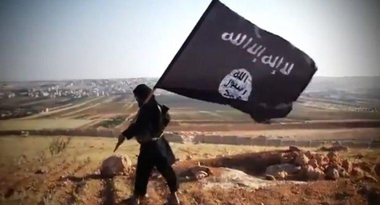 IS- Strijder met de bekende zwarte vlag. Beeld anp
