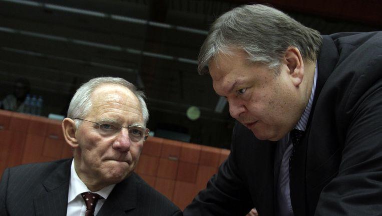 Jean-Claude Juncker en de Griekse minister van Financiën Evangelos Venizelos. Beeld ap