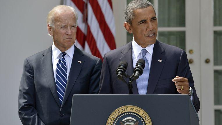 Obama geeft voor het Witte Huis zijn verklaring over Syrië. Naast hem vicepresident Joe Biden. Beeld reuters
