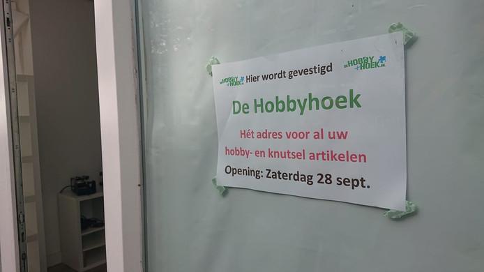 De opening wordt bij de entree aangekondigd.