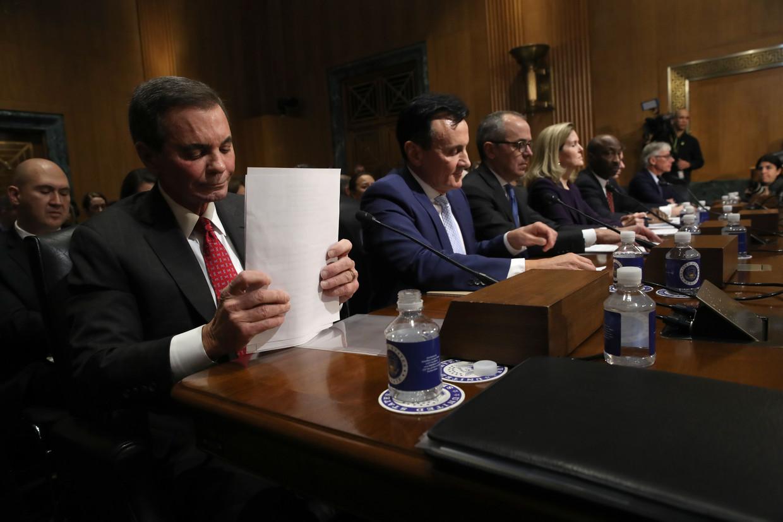 De zeven ceo's van Amerikaanse bedrijven op een rij tijdens de hoorzitting dinsdag in de Amerikaanse senaat. Beeld AFP