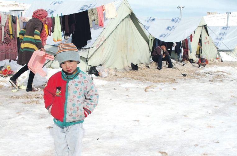 Bekaa-vallei (Libanon), 13 december: kind in een door sneeuw en vorst getroffen vluchtelingenkamp. Beeld afp
