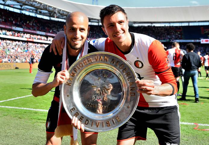 <br />Karim El Ahmadi en Steven Berghuis vieren de titel van Feyenoord.
