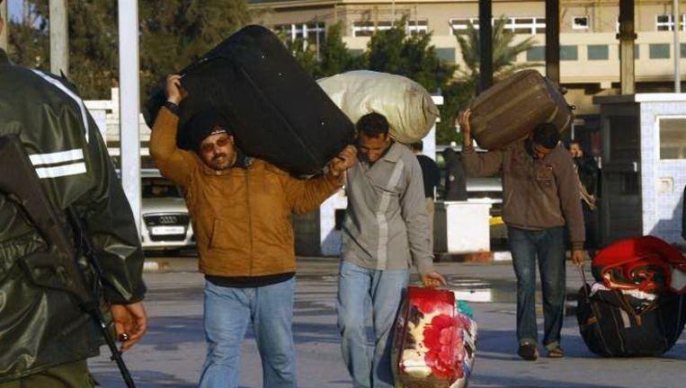 Egytenaren ontvluchten Libië. Foto: Reuters Beeld