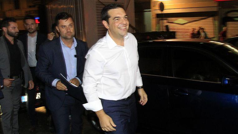 De linkse partij Syriza van premier Alexis Tsipras heeft zondag de parlementsverkiezingen gewonnen. Beeld null