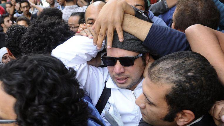 Ahmed Maher (met zonnenbril), leider van de zogeheten 6 April-beweging Beeld ap