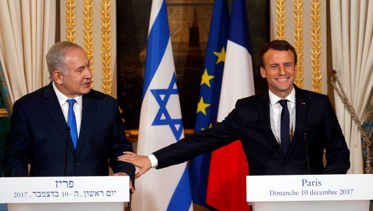 Premier Netanyahu en president Macron in Parijs, 10 december. Beeld null