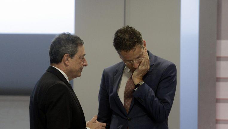 Er is geen plan B voor Griekenland, zegt Eurogroepvoorzitter Jeroen Dijsselbloem (rechts) stellig. Maar het feit dat daar toch aan gedacht moet worden, baart hem en zijn collega-ministers zorgen. Beeld epa