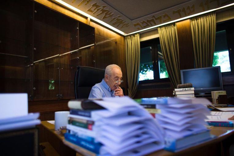 Peres trad in 2014 af als president. Op zijn laatste dag bereidde hij een speech voor ter verwelkoming van de nieuwe president. Beeld REUTERS