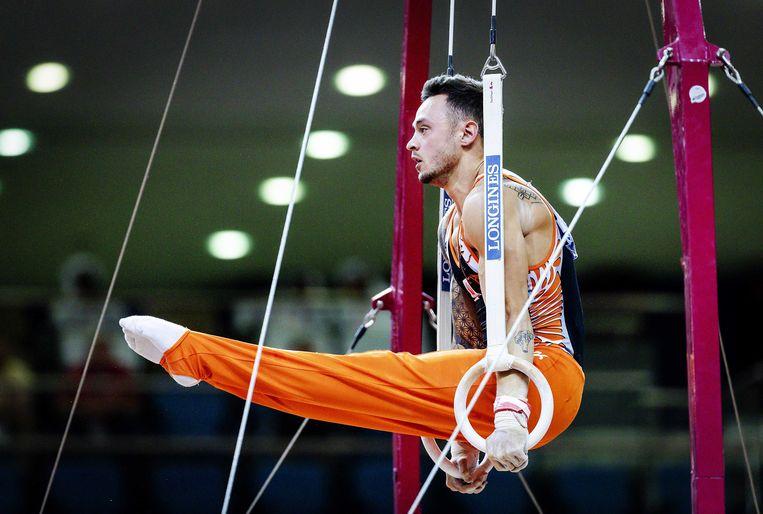 Bart Deurloo in de ringen tijdens de wereldkampioenschappen turnen in Doha, Qatar. Beeld ANP