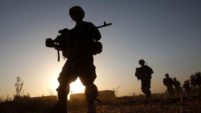 Amerikaanse soldaten in de buurt van Kandahar in Afghanistan. Beeld REUTERS