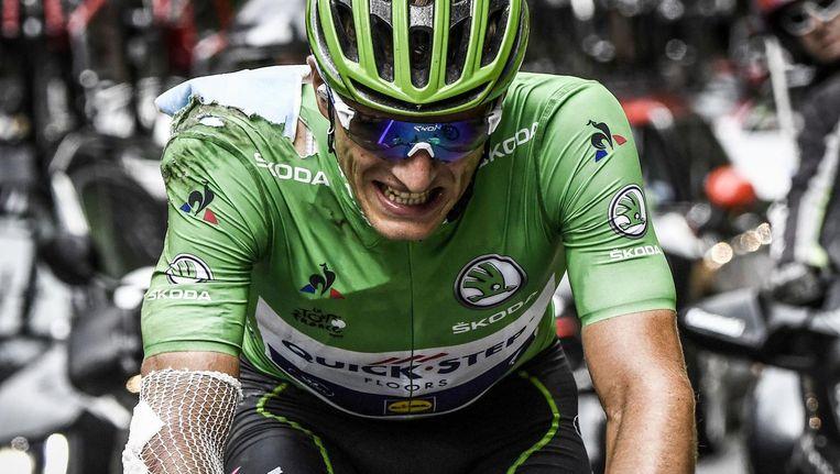 Een van pijn vertrokken gezicht van Marcel Kittel, die hard ten val kwam tijdens de Ronde van Frankrijk Beeld anp