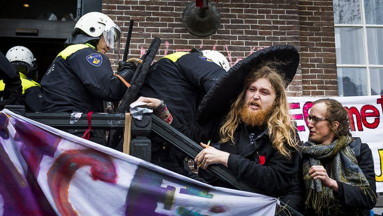 Studenten hielden vorig jaar het Maagdenhuis van de Universiteit van Amsterdam (UvA) bezet, uit protest tegen het bestuur van de universiteit. Beeld anp