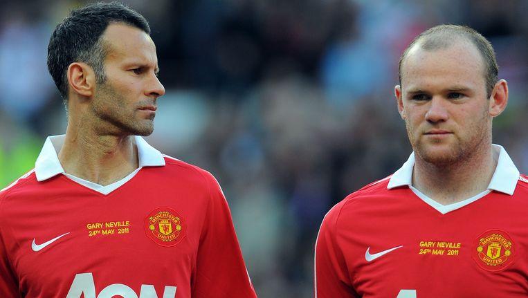 Manchester United-voetballers Wayne Rooney (R) en Ryan Giggs Beeld AFP