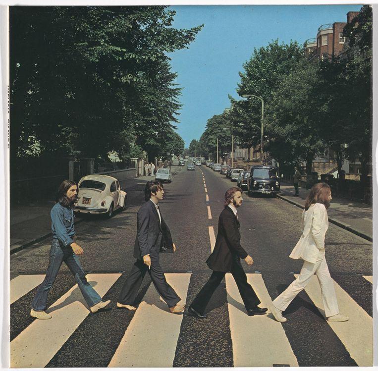 De iconische foto van The Beatles op het zebrapad bij de de Abbey-Road-studio. Beeld
