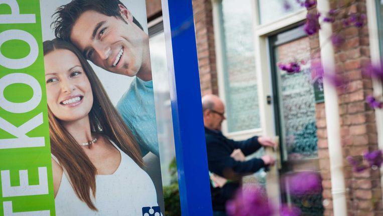 De toezichthouder heeft vastgesteld dat banken en verzekeraars een deel van hun hypotheekklanten te veel boeterente in rekening hebben gebracht Beeld anp