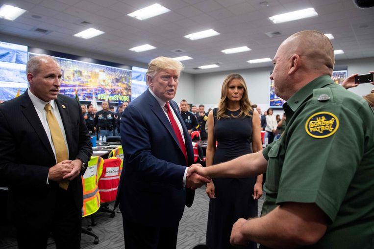 Donald Trump en zijn vrouw Melania in El Paso. Beeld AFP