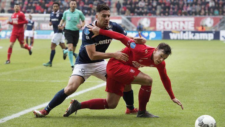 Sander Fischer van Sparta in duel met Twente-spits Tom Boere. Beeld anp
