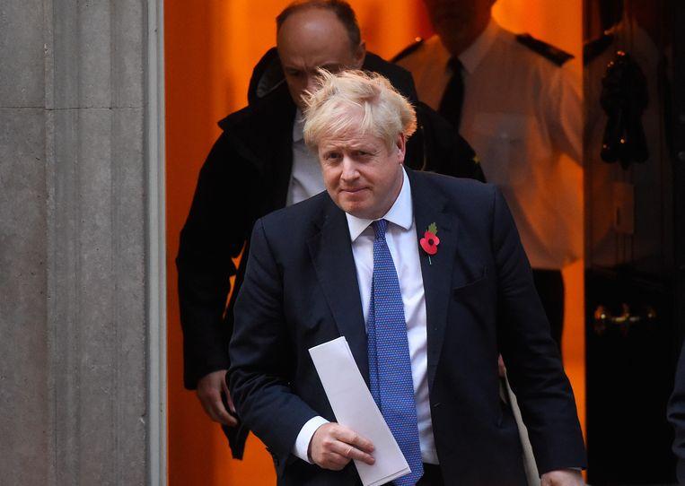 Boris Johnson verlaat Downing Street 10, op weg naar het Lagerhuis. Beeld Getty