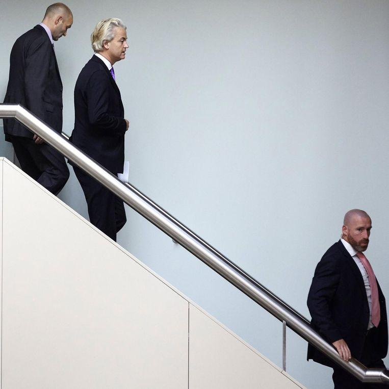 Geert Wilders is onderweg naar de plenaire zaal van de Tweede Kamer. Beeld Freek van den Bergh / de Volkskrant