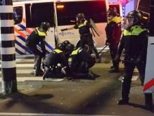 Onrustige nacht in Schilderswijk: agenten bekogeld met stenen, branden gesticht, vier aanhoudingen