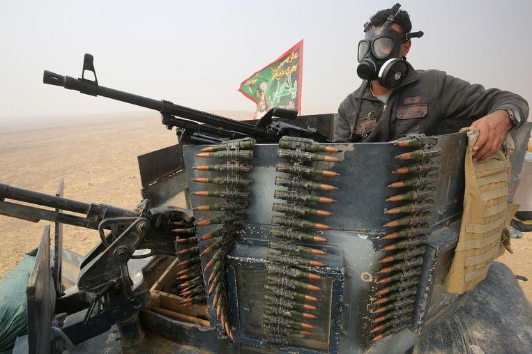 Een Iraakse militair in al-Shura, een regio ten zuiden van Mosul. Beeld afp