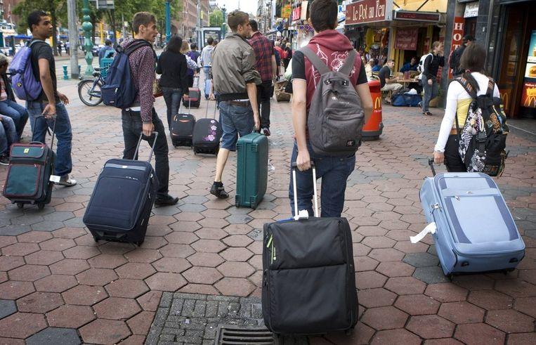 Toeristen op het Damrak in Amsterdam. © ANP Beeld
